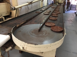 Chocolate turrón coming off the production line at Chocolates Pérez