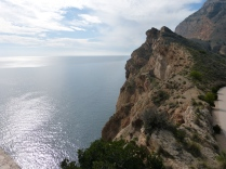 From the lighthouse terrace; look up to the radio antennas on top of the cliffs and down to the sea below. The waters off the Serra Gelada are a protected nature reserve.