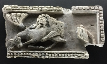 Stucco fragment from Villa Xauxelles on the outskirts of La Vila, showing a lion attacking a gazelle. On show at the MARQ archaeology museum in Alicante.