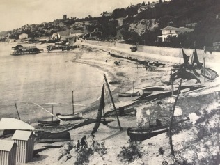Fishing boats on the old shingle beach. Before Villajoyosa's port was built in the 1920s, boats had to be hauled out of the water onto the pebbles.