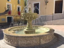 Relax in the peaceful plaza, with the restored Hospital de Pobres in the background.