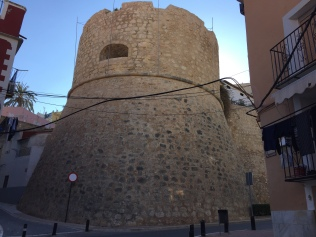 The thick town walls in Carrer Costera del Mar