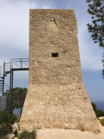 Torre d'Aguiló. Restored recently. The metal staircase allows you into the tower but is padlocked shut. Opening times are a mystery.