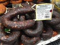 Morcilla; Spanish black pudding. The key ingredient is pig's blood; other ingredients include rice, garlic and onion. Can be eaten on its own or used in cooking