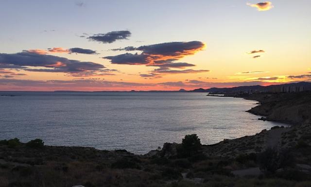 Sunset from cliffs Torre d'Aguilo walk