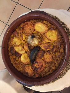 Rice cooked in a wood oven (arroz al horno de leña). Prepared in an earthenware bowl, it's a typical country rice dish. No fish or seafood involved.