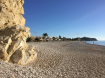The shingle beach of Playa Paraiso looking back towards the tower on the headland at Malladeta