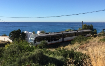 Trundling happily along the coast with some beautiful views; the tram from Alicante nears Villajoyosa