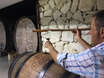 Sampling fondillón in the sacristia at Bodegas Monóvar. A small quantity of wine is taken from the barrel using this bamboo tool and tipped into a glass.
