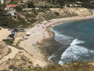 Looking down on the shingle beach of Platja del Xarco from the watchtower