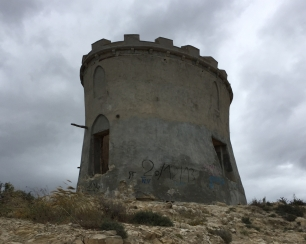 The ruined tower on the headland at Malladeta is the start of the walk