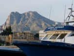 The Puig Campana mountain seen at dusk from the fish quay