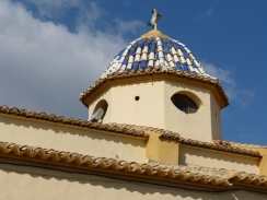 Typical church roof with blue and white tiles