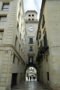 Walk beneath the town hall clock tower into the Plaza de la Santísima Faz