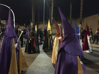 Easter procession with cofradia members wearing the traditional capirotes (hoods) of Semana Santa