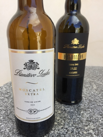 The excellent Moscatel Extra dessert wine, made from the Moscatel Romano grape, with the equally good Primitivo Quiles Fondillón behind