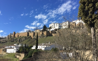 Looking up to Ronda city walls built by the Arabs, who ruled this part of Spain for centuries