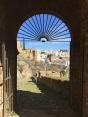 Looking through a gateway in the Moorish walls of Ronda