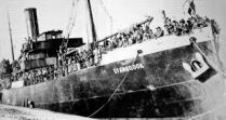 The Stanbrook, crammed with refugees, on the dockside of Alicante in March 1939. She would be torpedoed and sunk only a few months later in the first year of World War Two.