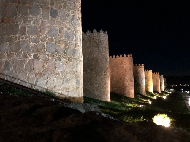 Avila city walls by night