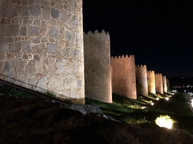 Avila city walls by night