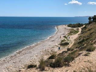 Follow the path behind the pebble beach of Playa del Barranc d'Aigües from the car park to the start of the climb